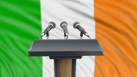 Podium lectern with microphones and Irish Flag in background Reklamní fotografie