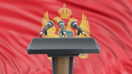 Podium lectern with microphones and Montenegrin flag in background