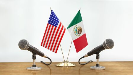 Microphones and flags pair on a desk over defocused background Banque d'images
