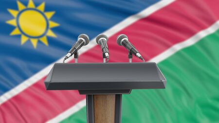 Podium lectern with microphones and Namibia flag in background Reklamní fotografie