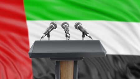 Podium lectern with microphones and United Arab Emirates flag