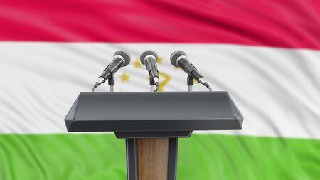Podium lectern with microphones and Tajik Flag in background Reklamní fotografie