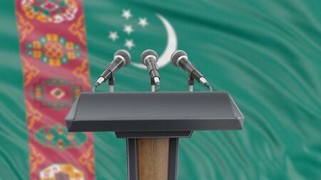 Podium lectern with microphones and Turkmenistan flag in background