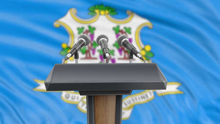 Podium lectern with microphones and Connecticut flag in background Reklamní fotografie