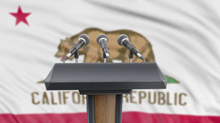 Podium lectern with microphones and California flag in background