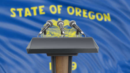 Podium lectern with microphones and Oregon flag in background Reklamní fotografie