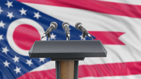 Podium lectern with microphones and Ohio flag in background
