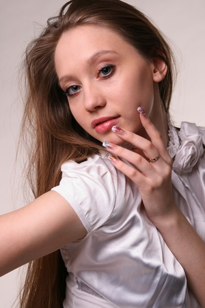 Pretty girl showing her manicure. photo