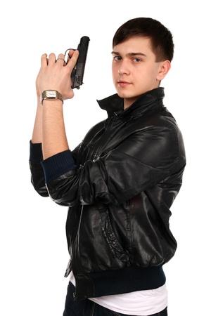 Young man with gun. photo