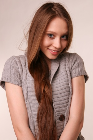 Portrait of pretty girl in grey woolen shirt. photo