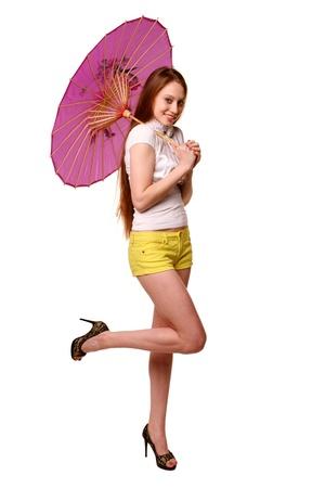 Pretty girl posing with umbrella. photo