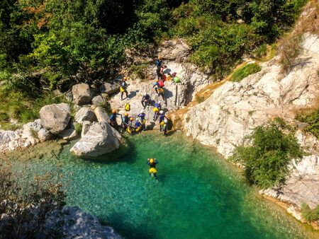 Departure of a canyoning group at Rocchetta Nervina, Liguaria - Italy