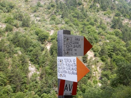 Signs with indications of the paths around Rocchetta Nervina, Imperia - Italy