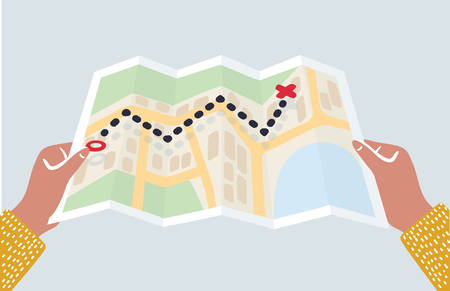 Vector cartoon illustration of Human Hands holding paper map. Folded map in hands of men. Tourist look at map of the city. Destination and route is looking for. Travel concept.