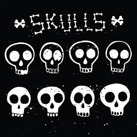 Illustration set of white skulls in ink on black background