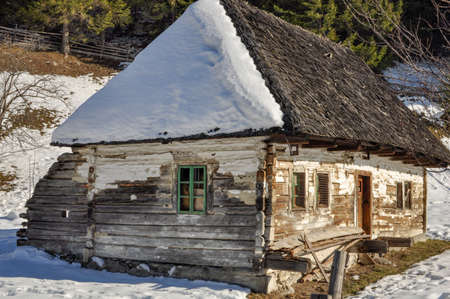An old barn  in the Moeciu de Jos village in Romania. It is used only in spring, summer and autumn seasons Stock Photo