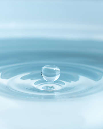 Water drop on water background