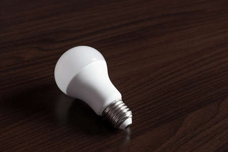 led bulb on wooden background
