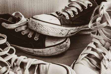 Old shoes on brown wood background