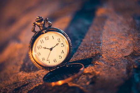 An old pocket watch photographed close to the blurred background Reklamní fotografie