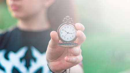 An old pocket watch in your hand Archivio Fotografico