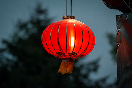 Chinese red lantern hanging on the stainless steel rail 免版税图像