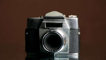 old camera on dark background Archivio Fotografico