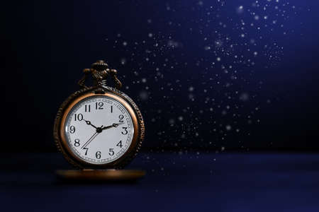 Old pocket watch on dark background