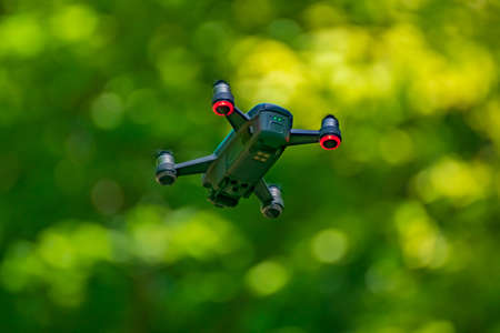 flying drones on green background blurred