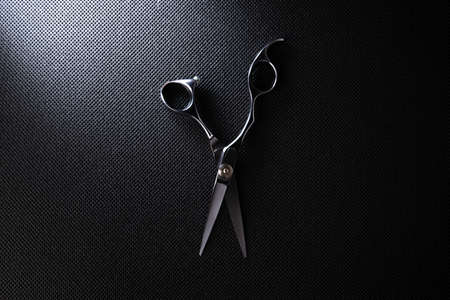 professional scissors on black background Imagens