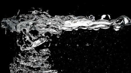 Clear water surface on a black with ripple and bubbles Stock Photo