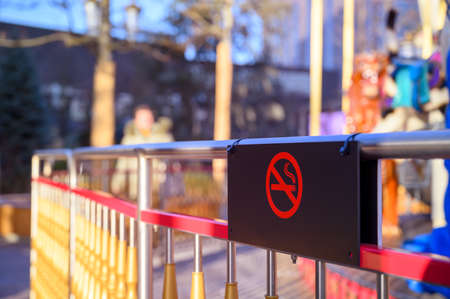 Smoke sign in children's playground. Sunny summer day