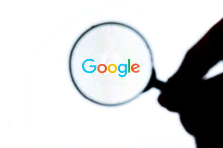 Timisoara,Romania-February 21,2019:Google homepage on the screen under a magnifying glass. Google is world's most popular search engine