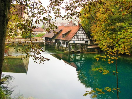 water mill: Water mill at Blautopf in autumn, Blaubeuren, Germany Stock Photo
