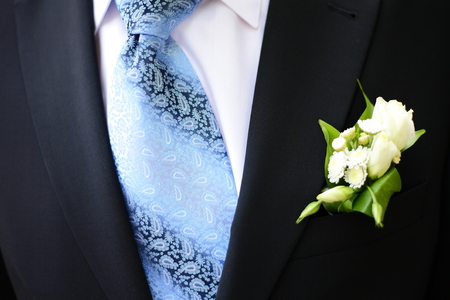 boutonniere: Groom ceremonial suit, boutonniere and tie Stock Photo