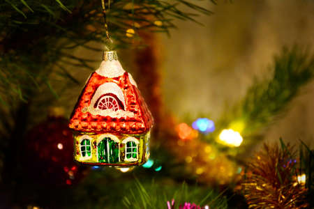 Christmas toy little house on the tree Reklamní fotografie