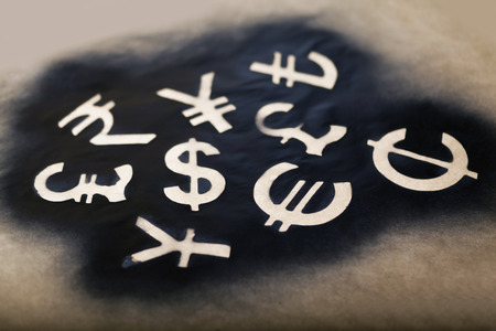 taint: International black currency units on dappled background