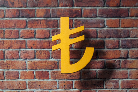 tl: International money icon and currency units front of the British style wall