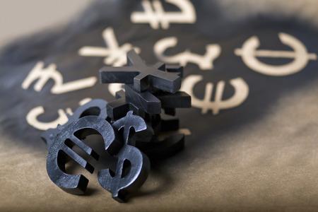 International black currency units on dappled background