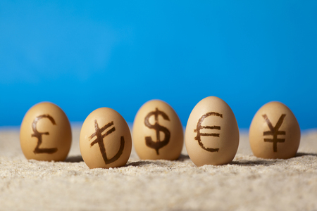 tl: Universal money icon painted on eggs on the sand Stock Photo