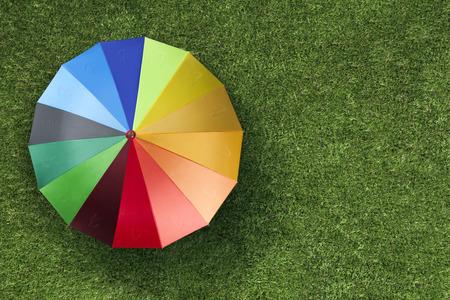 turkish lira: Turkish Lira currency units on colourful umbrella on green grass