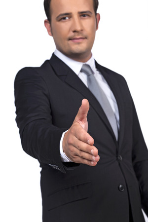 reach out: Businessman reach out a hand to deal Stock Photo