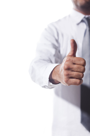 white collar: White collar businessman is doing thums up sign Stock Photo