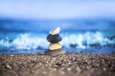 successively: Different pebbles are standing successively at wavy sea side