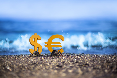 Dollar and Euro currency icons are standing on the wavy sea side