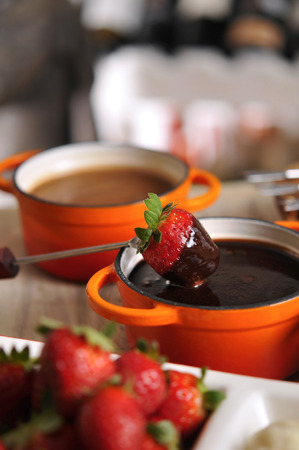 Fondue with strawberry, fruit and hot chocolate Stock Photo