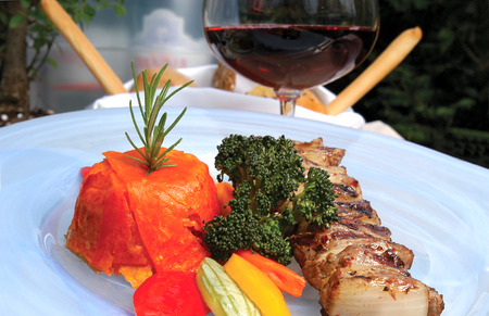 garniture: Shish kebab lamb meat with red wine and vegetables in the dish
