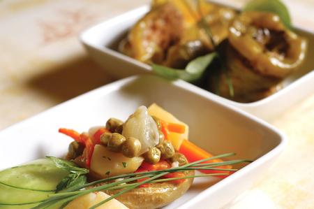 artichoke with garniture in a dish