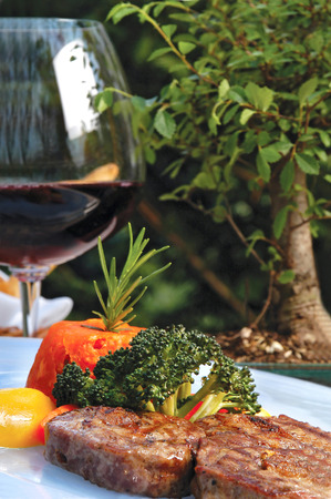 beefsteak with red wine and vegetables in the dish