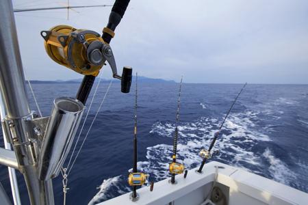 jigging: Fishing gears and fisherman boat sailing away in open sea